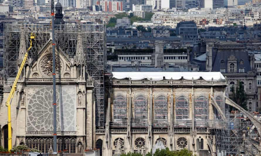 Temporary tarpaulins cover the roof of the cathedral to protect it from rain damage.