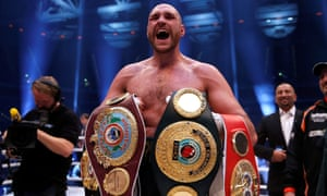 Tyson Fury shows off the belts after beating Wladimir Klitschko in 2015