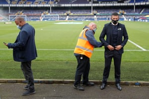 Former players John Barnes and Tim Cahill prepare to show their opinions on television before the match in Goodison Park.