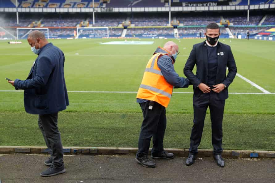 Former players John Barnes and Tim Cahill prepare to air their views on television before the match at Goodison Park.