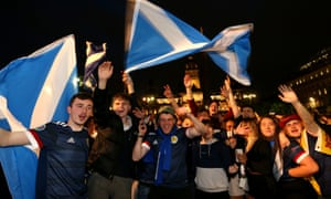Scotland fans celebrate the result in Glasgow.