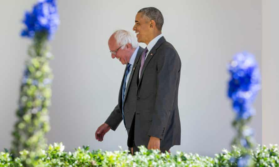 Obama walks with Democratic presidential candidate Bernie Sanders down the Colonnade during their meeting at the White House in Washington on Thursday.
