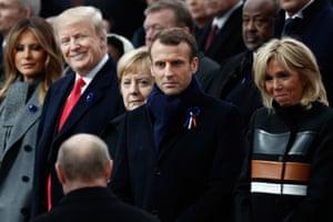 Donald and Melania Trump with Angela Merkel, Macron, Brigitte Macron and Putin.