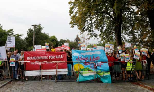 "Protesters hold up signs saying ""Refugees Welcome"" outside the election party of Alternative für Deutschland (AfD) in Potsdam, September 2019."