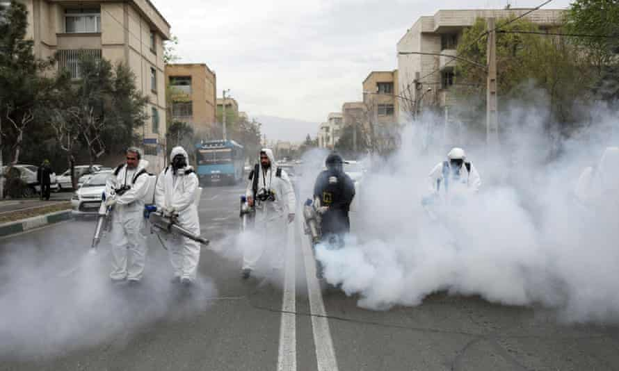 Firefighters disinfect the streets in Tehran. Last week a new list of people and companies linked to the Revolutionary Guard was targeted.