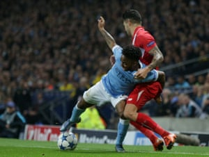 Raheem Sterling holds off the challenge of Vitolo.