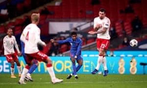 England's Marcus Rashford has a go from distance.