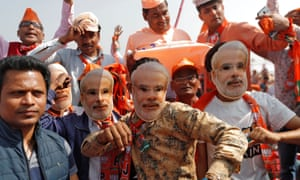 Supporters of Narendra Modi attend an election campaign rally in Meerut, Uttar Pradesh.
