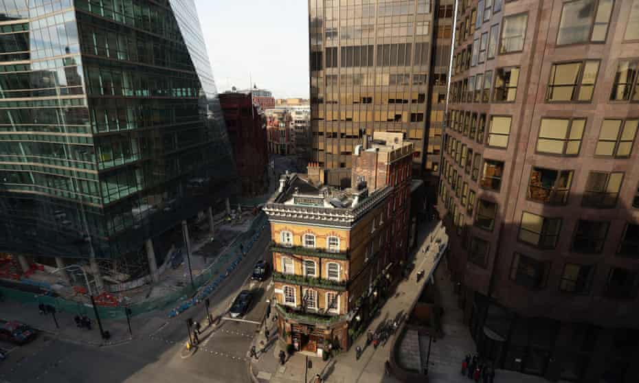 The Albert Tavern, a Victorian public house, stands next to modern office developments on Victoria Street in London.