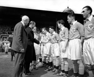 The Duke of Edinburgh shakes hands with Blackpool's William Perry before kick-off.