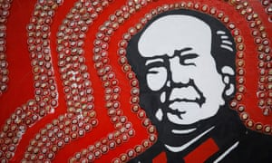 Badges of Mao Zedong decorate an image of Mao