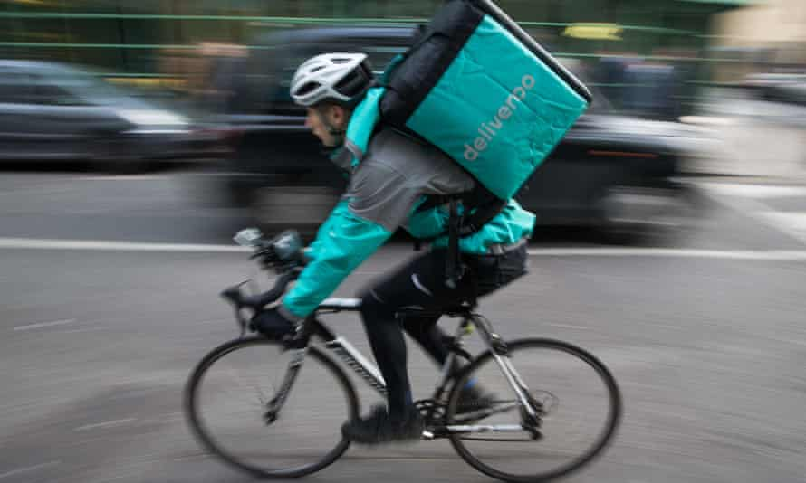 A Deliveroo rider on a London street