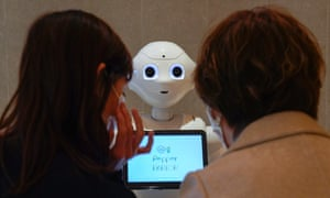 Pepper, a robot developed by SoftBank Robotics, welcomes customers in Tokyo, Japan, on 5 November. In the US, 11 million people were unemployed in October.