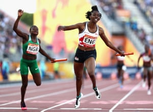 Lorraine Ugen of England crosses the line to win gold ahead of Rosemary Chukwuma of Nigeria in the women's 4x100m relay final.