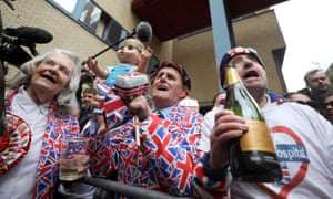 Supporters of the royal family celebrate outside the Lindo Wing of St Mary's Hospital, including Terry Hutt (c) and John Loughrey (r).