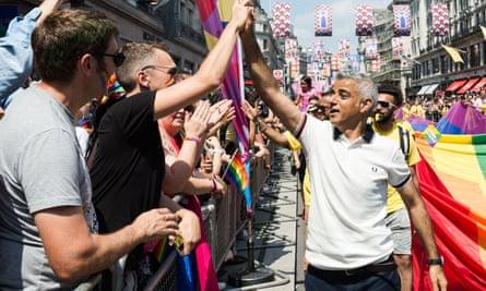 Sadiq Khan high-fives people during Pride in London