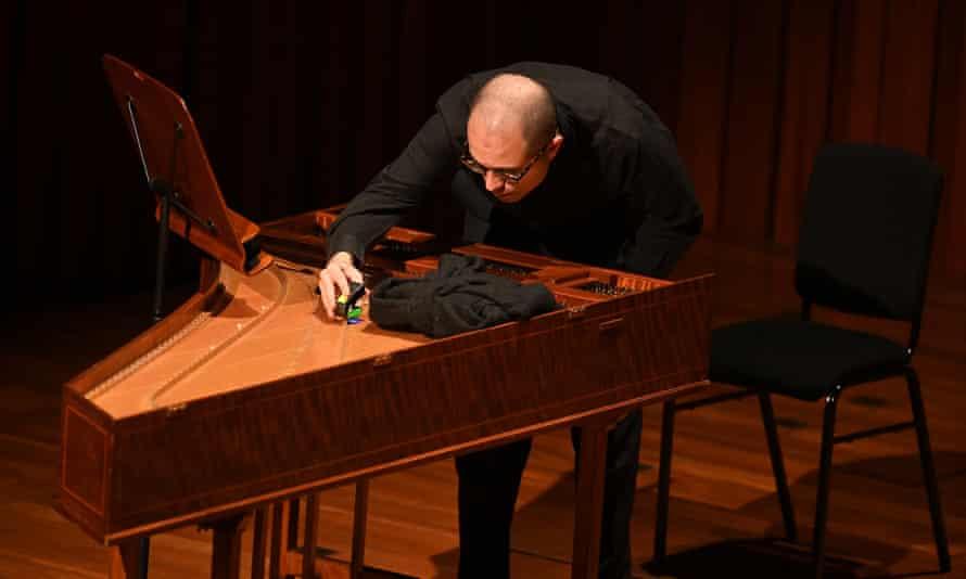 Esfahani prepares his harpsichord.