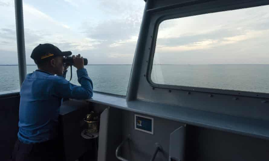 Indonesia's navy has fired warning shots at several boats with Chinese flags that it accused of fishing illegally near the Natuna Islands.
