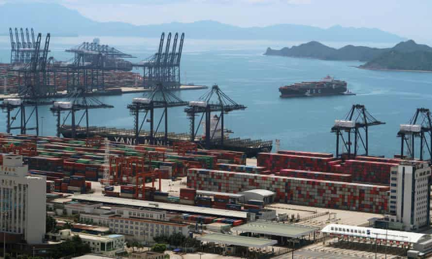 A cargo ship carrying containers is seen near the Yantian port in Shenzhen following the Covid-19 outbreak in Guangdong province