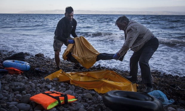 Rescuers remove the body of a boy washed up on the shores of Lesbos