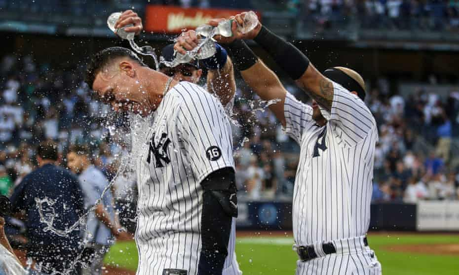 Aaron Judge is doused with water after his game-winning RBI single
