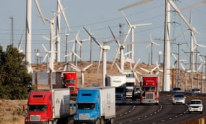 Time to choose: polluting traffic passes a non-polluting windfarm in California.