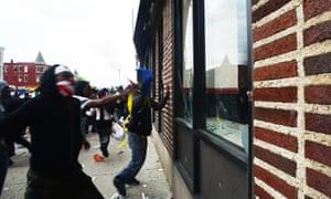 Protestors smash windows.