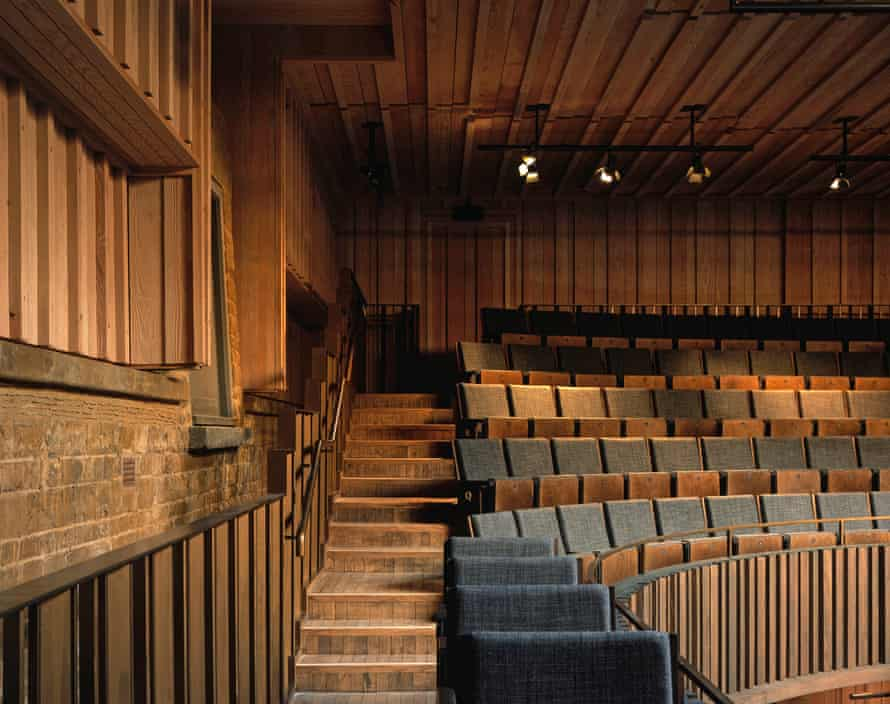The stone walls and Douglas fir panelling of the auditorium.