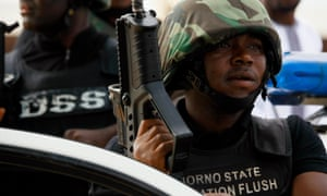 The Borno state task force, Operation Flush, stands guard during a religious celebration in Maiduguri, in 2013.
