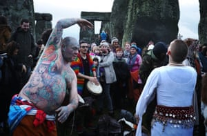 Druids, pagans and revellers dance at Stonehenge