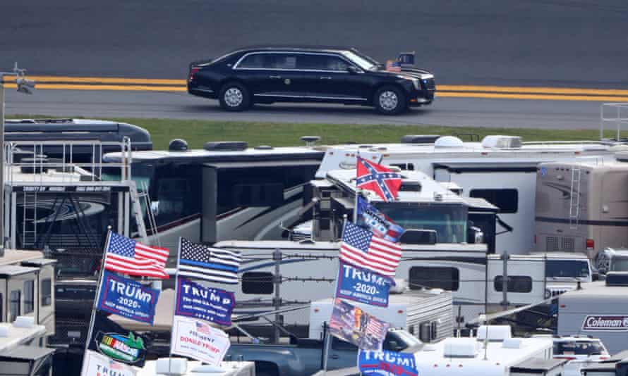 Trump flags are visible in the infield as the presidential motorcade arrives prior at Daytona International Speedway.