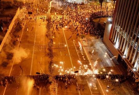 A police cordon faces protesters in San Martin de Lima square
