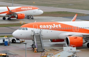Easyjet planes are seen parked at Luton airport.