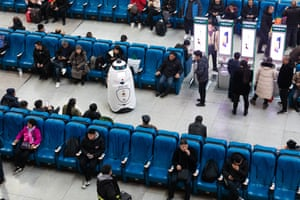 Changchun, China. A police robot patrols a train station in Jilin province. The device can monitor and recognise passengers' faces to compare with those of escaped criminals