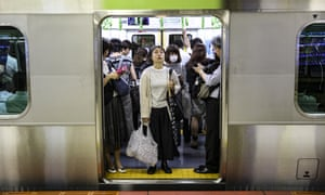 Passengers are seen at a subway station in Tokyo