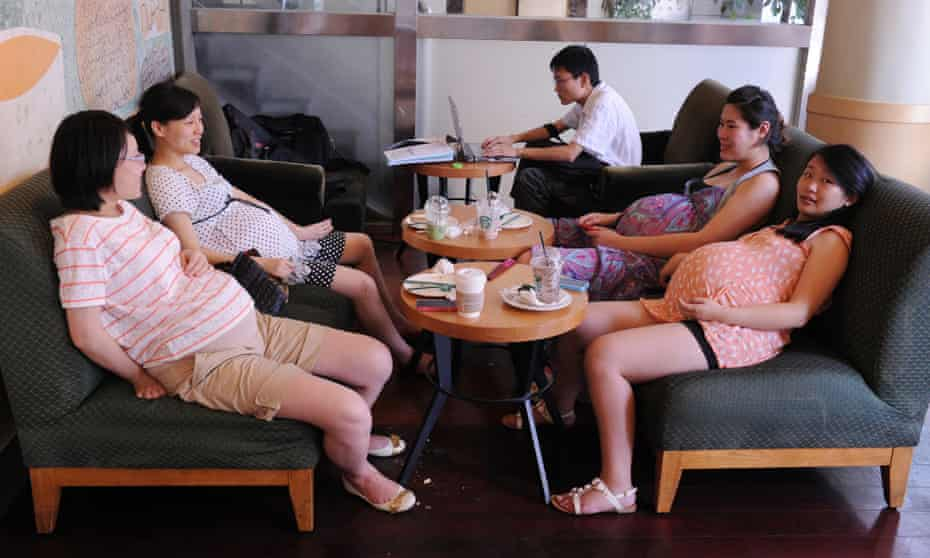 Four pregnant women in a coffee shop in Shanghai