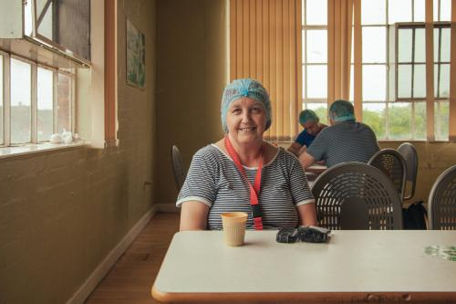 Carol, Cracker Packer by Matt MacPake 'The iconic Carr's of Carlisle factory has been synonymous with the city for nearly 200 years. It's home to the famous Carr's Table Water Biscuit as well as British classics such as Custard Creams, Bourbons, Ginger Nuts and many others.'