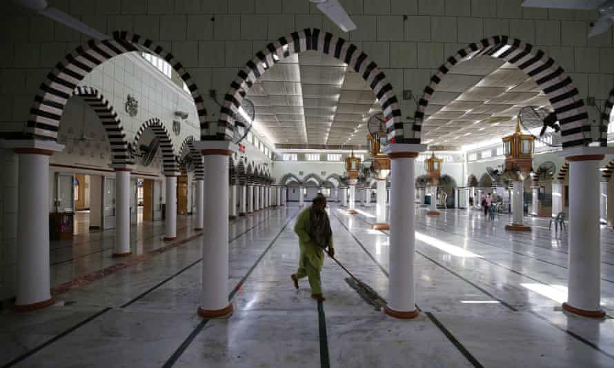 A man cleans a mosque ahead of Ramadan, during lockdown of the Sindh province, in Pakistan, on 23 April.