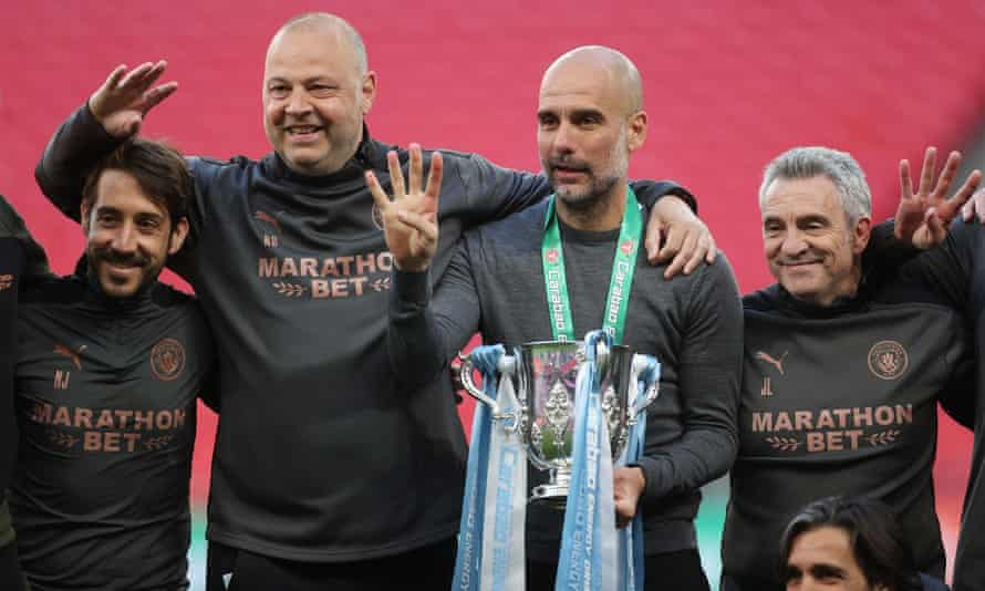 Guardiola celebrates his fourth League Cup win with Manchester City last weekend.