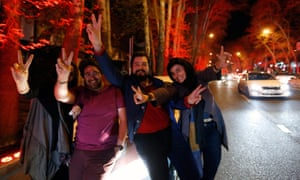 Iranians celebrate on the streets of Tehran.