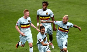 Eden Hazard celebrates scoring Belgium's third goal with his team mates.