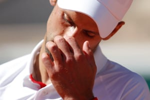Novak Djokovic looks dejected.