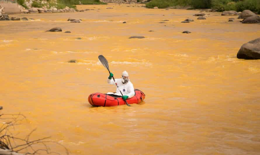 Nathan Shoutis paddles the discolored Animus river in Durango, Colorado, shortly after an EPA remediation project resulted in the breach of millions of gallons of toxic mining waste