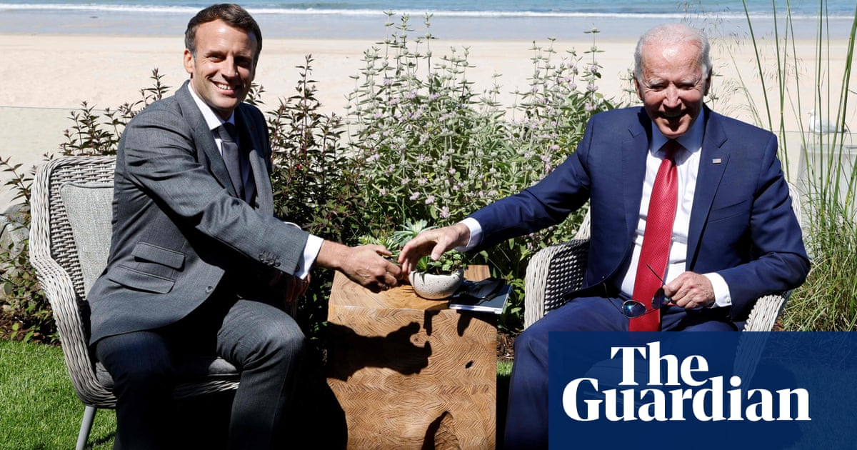 'America is back': Biden gets thumbs up from Macron at G7 – video