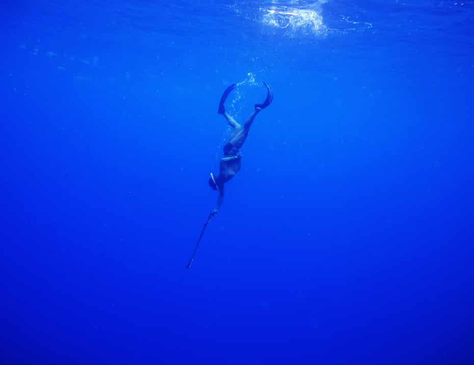 Fisherman turned Oracabessa Bay fish sanctuary warden and dive master, Ian Dawson, dives while spearfishing