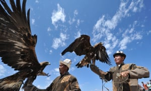 Hunters with their golden eagles at the Ethno Fest festival in Ton