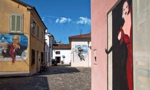 Fellini-inspired murals in Piazzetta Gabena, Borgo San Giuliano, Rimini, Italy.