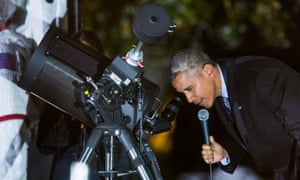 Barack Obama looks through a telescope during the second White House Astronomy Night.