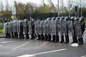 Police carrying riot shields