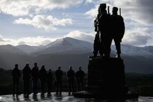 Servicemen and veterans gather at the Commando Memorial, Spean Bridge